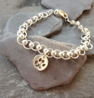 Silver circles bracelet with tiny pawprint charm